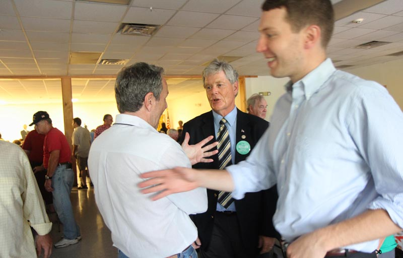 A SPECIAL MEETING: Attorney Tom Nale of Waterville, left, chats with acting District Attorney Alan Kelley of West Gardiner prior to a special meeting to nominate Kelley or Rep. Maeghan Maloney, D-Augusta, as the Democrat candidate to succeed Evert Fowle. The meeting was held at the Poulin-Turner Union Hall in Skowhegan. At far right, is Nale's son, Tom Nale, Jr.