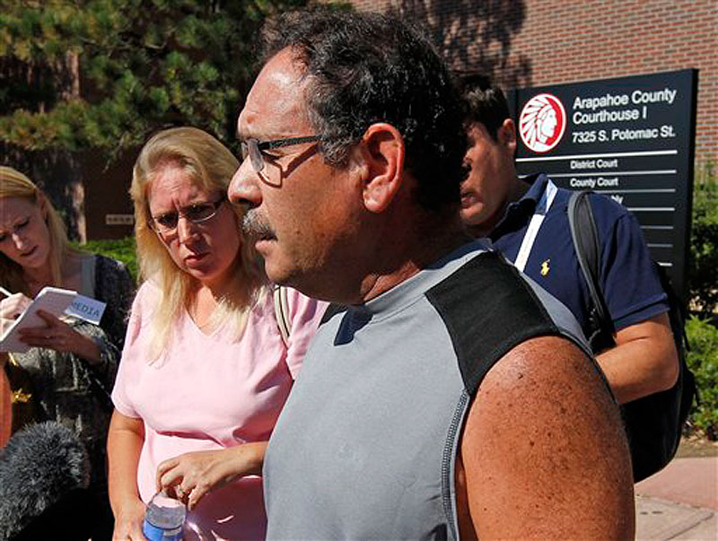 "David Sanchez, whose son-in-law was critically wounded, speaks after a court appearance by shooting suspect James Holmes at the Arapahoe County Courthouse, Monday, July 23, 2012, in Centennial, Colo. Twelve people were killed and dozens were injured in the shooting attack early Friday at an Aurora, Colo., theater during a showing of the Batman movie, ""The Dark Knight Rises."" Sanchez's pregnant daughter escaped uninjured. (AP Photo/Alex Brandon)"