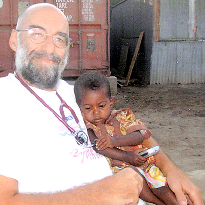 Dr. David Austin holds a child he treated during his latest Doctors Without Borders assignment in Djibouti earlier this year.