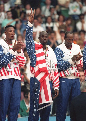 "FILE -In this Aug. 8, 1992 photo, the USA's Scottie Pippen, left, with Michael Jordan, center, and Clyde Drexler, pose with their gold medals after beating in Barcelona. Jordan tells the Associated Press that� he laughed when heard Kobe Bryant said this year's USA Olympic basketball team could beat the Dream Team that Jordan played on. Jordan said ""It's not even a question"" who would have won that game. ""We had 11 Hall of Famers on that team. Whenever they get 11 Hall of Famers you call and ask me."" (AP Photo/Susan Ragan)"