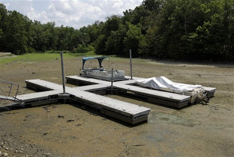 Boats sit on the bottom in a dry cove at Morse Reservoir in Noblesville, Ind., Monday, July 16, 2012. The reservoir is down nearly 6 feet from normal levels and being lowered 1 foot every five days to provide water for Indianapolis. (AP Photo/Michael Conroy)