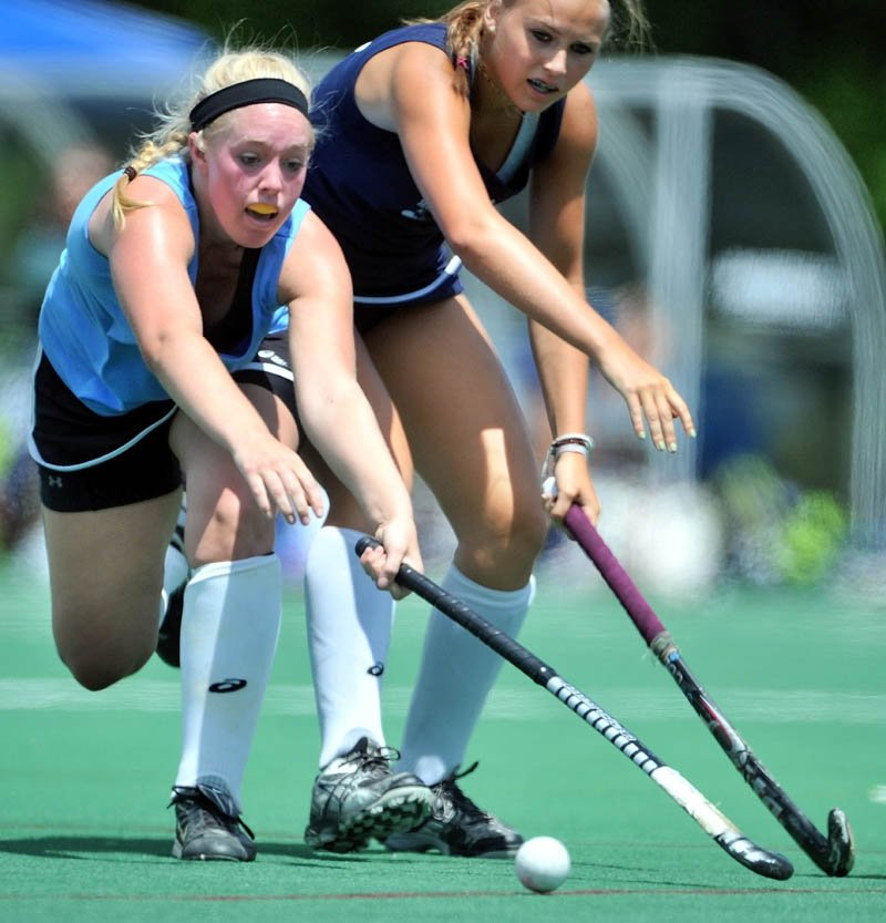 ALL-STARS: Mikayla Fitzmaurice, left, of Skowhegan and the East battles for the ball with West's Alice Sandborn of Lake Region and the West in the McNally Senior All-Star field hockey game Saturday at Colby College. The East defeated the West 3-2.