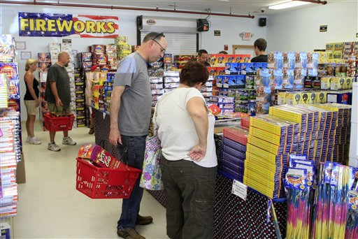 Customers fill up on 4th of July fireworks at the Hilltop Fireworks store, on Tuesday in Somersworth, N.H.