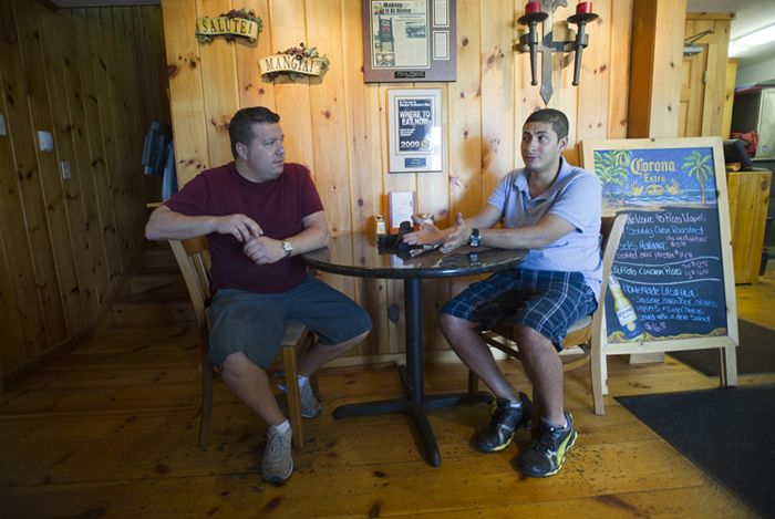 "David Giarusso, left, and Carlos Perez, owners of Pizza Napoli in Ogunquit at their business on Monday. ""We're turning a chapter and everyone's moving on with their lives,"" says Perez. Adds Giarusso: ""I feel two people want to get married, they should be able to get married."""