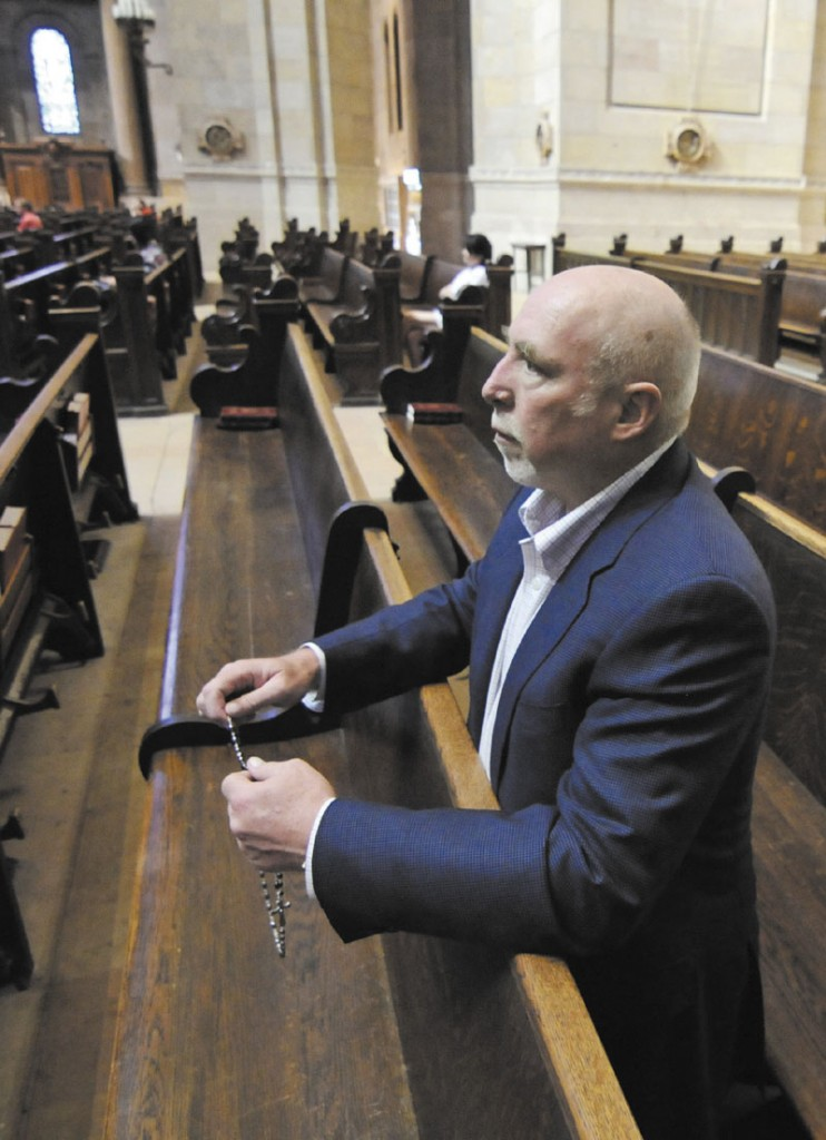 """Frank Schubert, who was a well-paid consultant, prays his daily rosary before Mass at the St. Paul Cathedral. Schubert dropped his corporate portfolio to focus on the nationwide battle to keep gay marriage illegal and is now managing four statewide campaigns including Maine where the issue is on the ballot in the fall. """"Marriage was created by God to bring men and women together to raise children,"""" he says."""