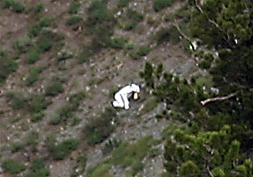 In this Sunday, July 15, photo, a person is seen in a goat suit in the Wasatch Mountains on Ben Lomond peak outside of Ogden, Utah.