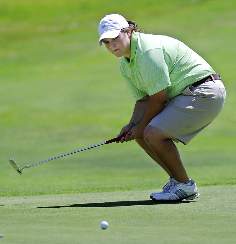 STAFF PHOTO BY ANDY MOLLOY COME BACK KID: Emily Bouchard watches a putt Wednesday during the third day of the Maine Women's Amateur golf tournament at the Augusta Country Club in Manchester.