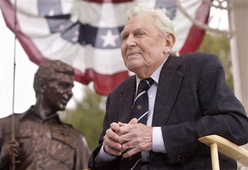 "This Oct. 28, 2003 file photo shows actor Andy Griffith sitting in front of a bronze statue of Andy and Opie from the ""Andy Griffith Show,"" after the unveiling ceremony in Raleigh, N.C. Griffith, whose homespun mix of humor and wisdom made ""The Andy Griffith Show"" an enduring TV favorite, died Tuesday, July 3, 2012 in Manteo, N.C. He was 86. (AP Photo/Bob Jordan, File)"