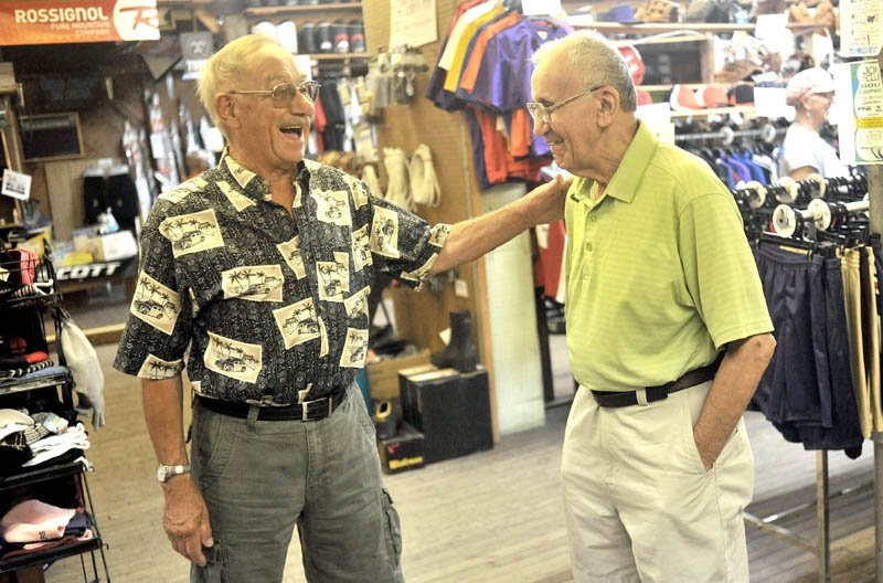 GOOD BYE, PRO: Harold Joseph, right, shares a laugh with long-time customer John Levesque, left, during Joseph's retirement party Saturday at his store on Maine Street in Fairfield.