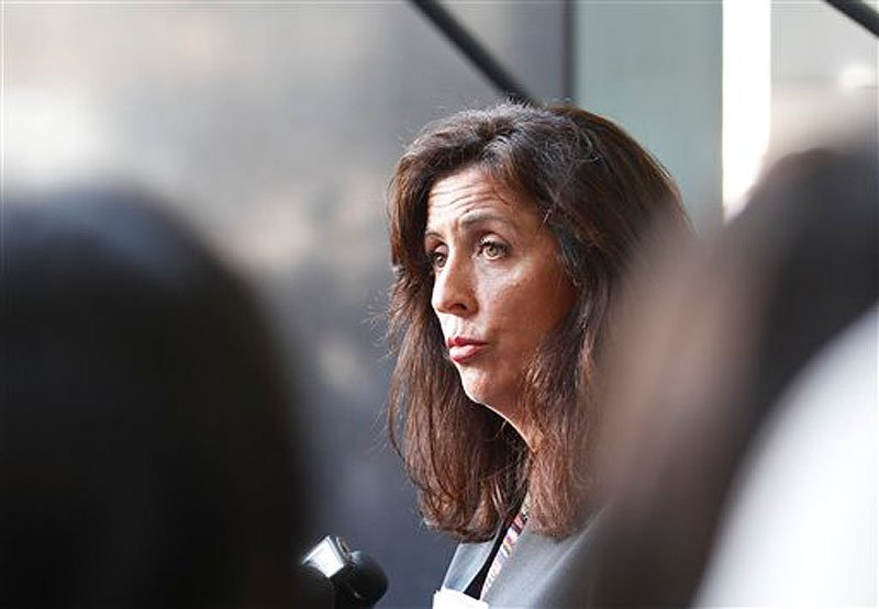 Lisa Damiani, an attorney and spokesperson for the parents of alleged Colorado mass murderer James Holmes, listens to a question during a news conference Monday, July 23, 2012 in San Diego. Damiani says Holmes' mother had no idea he was believed to be the gunman who killed a dozen people in a Colorado theater until a reporter contacted her at her San Diego home. (AP Photo/Lenny Ignelzi)