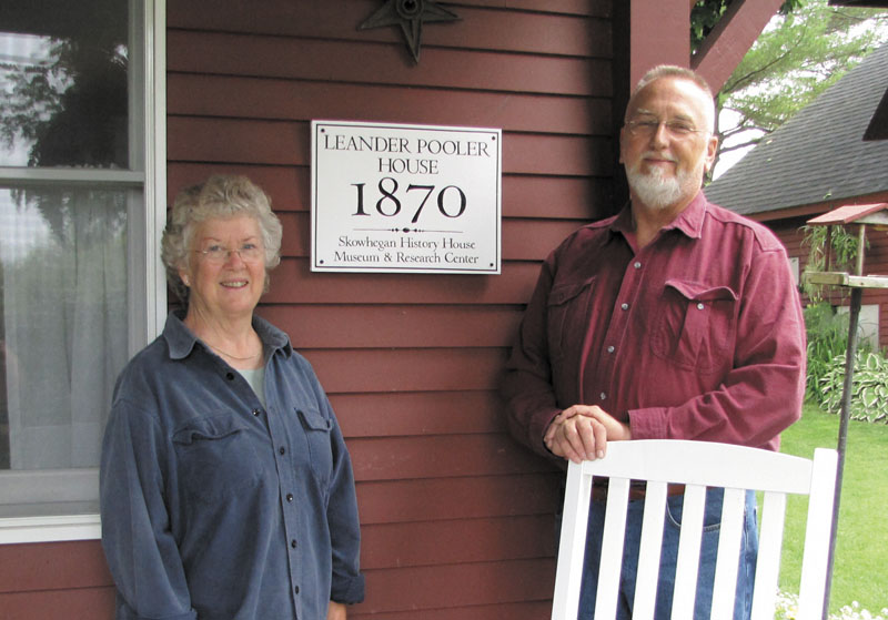 Mary Lou Holden and Henry Mollerus stand in front of their historic home on Parkman HIll in Skowhegan.