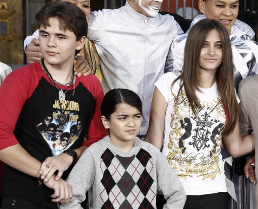 This Jan. 26, 2012, photo shows, from left, Prince Jackson, Blanket Jackson and Paris Jackson after a hand and footprint ceremony honoring their father Michael Jackson in front of Grauman's Chinese Theatre in Los Angeles.