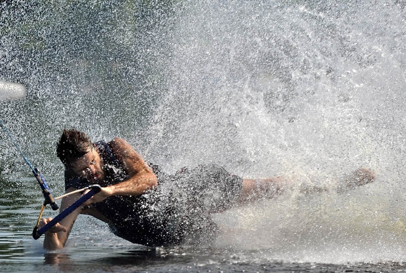Shane Maroon of Waterville, wipes out during a run on the wake board on Messalonskee Lake in Oakland on Friday morning.