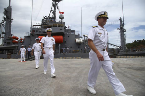 U.S. navy officers disembark a ship during a port call at Da Nang port, Da Nang, Vietnam, Friday, 15 July 2011. A treaty governing the high seas is all but dead in the Senate after two Republican senators announced their opposition Monday, July 16, 2012. Senate Republicans now have 34 votes to block it.