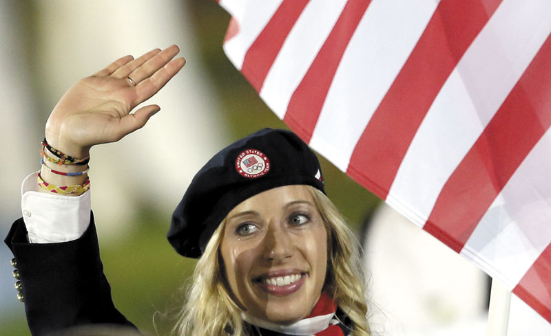 Gold medal fencer Mariel Zagunis carries the United States flag during the opening ceremony at the 2012 Summer Olympics on Friday in London.