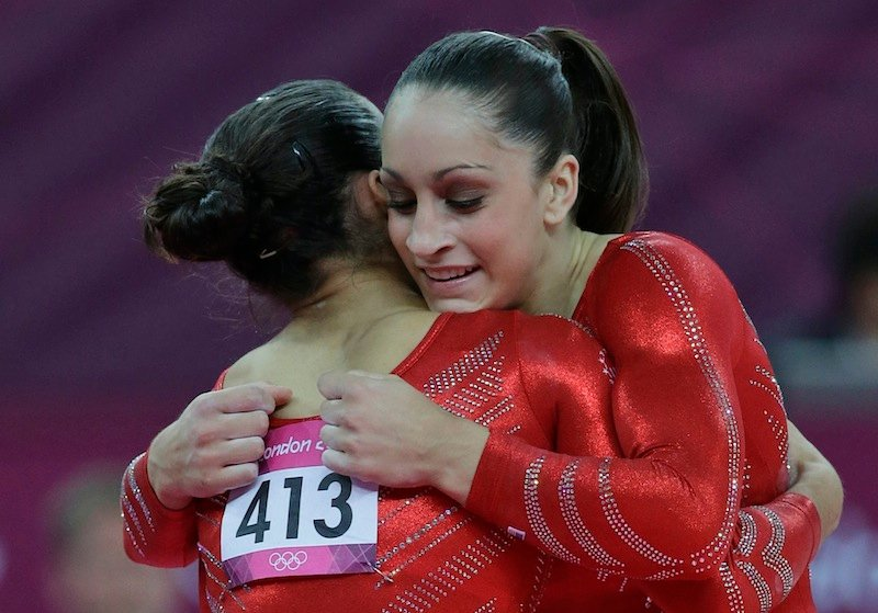 U.S. gymnast Jordyn Wieber, right, hugs U.S. gymnast Alexandra Raisman, after finishing her floor exercise during the Artistic Gymnastics women's team final at the 2012 Summer Olympics, Tuesday, July 31, 2012, in London. (AP Photo/Julie Jacobson) 2012 London Olympic Games Summer Olympic games Olympic games Sports Events XXX Olympiad