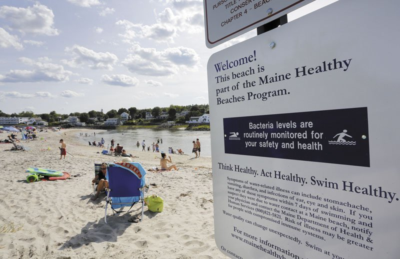 Visitors enjoys the sand and water at Riverside Beach in Ogunquit on Tuesday.