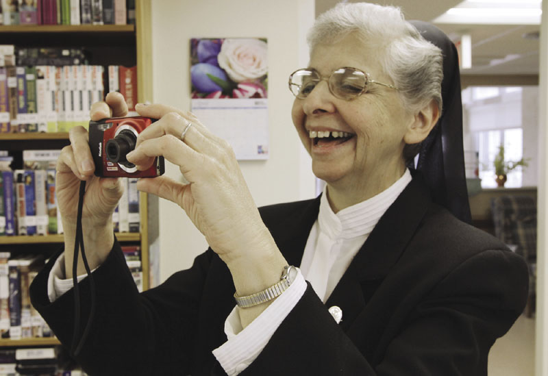 Sister Elaine Lachance takes a photo at the St. Joseph Convent in Biddeford in April. Good Shepherd Sisters of Quebec is opening its doors to increase interest. (AP Photo / Pat Wellenbach)