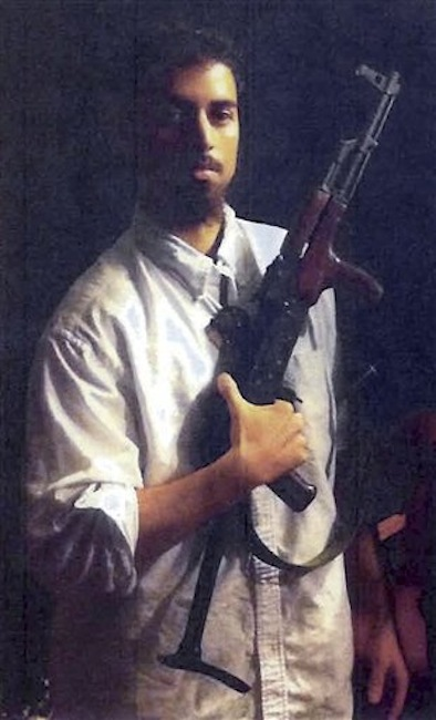 This section of an undated photo released by the U.S. Attorney's Office, which had been presented as a government exhibit at a 2011 hearing, shows Rezwan Ferdaus, of Ashland, Mass. Court documents filed Tuesday, July 10, 2012 said Ferdaus, who is charged with plotting to fly remote-controlled model planes packed with explosives into the Pentagon and U.S. Capitol, plans to plead guilty to two charges on July 20, 2012 in federal court in Boston. (AP Photo/U.S. Attorney's Office)