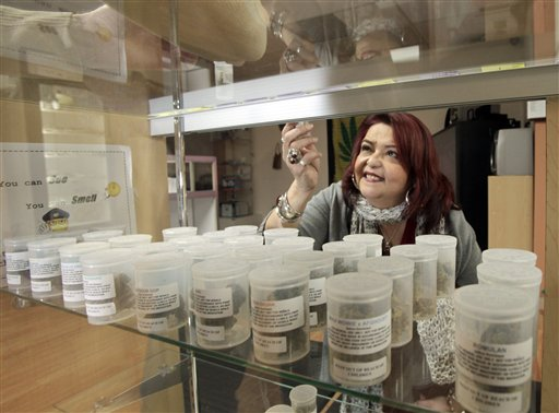 Yamileth Bolanos, who runs Pure Life Alternative Wellness Center, selects a vial of marijuana for a client at her store in Los Angeles in this 2010 photo.