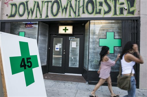Pedestrians walk past a medical marijuana dispensary in the Echo Park area of Los Angeles on Tuesday.