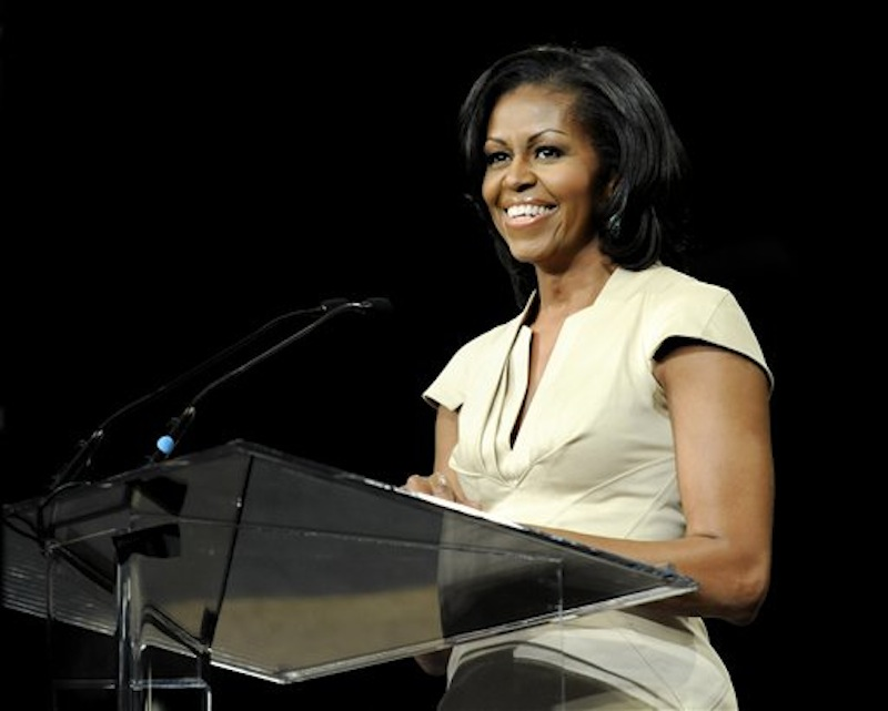 "In this June 23, 2012 file photo, first lady Michelle Obama gives the keynote address to the African Methodist Episcopal Church general conference in Nashville, Tenn. There are conflicting reports about threatening comments a police officer may have made about first lady Michelle Obama, the District of Columbia police chief said Friday, July 13, 2012. The department and the Secret Service are investigating an allegation of what it says were ""inappropriate comments"" about the first lady, allegedly made this week by a city officer who worked as a member of a motor escort for the White House. (AP Photo/Donn Jones) Michelle Obama"