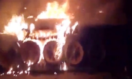 This image made from amateur video released by the Shaam News Network, purports to show a burning Syrian military tank in Damascus, Syria. Anti-regime activists say government forces are shelling a number of neighborhoods in and around the capital Damascus a day after a bomb killed three members of President Bashar Assad's inner circle.