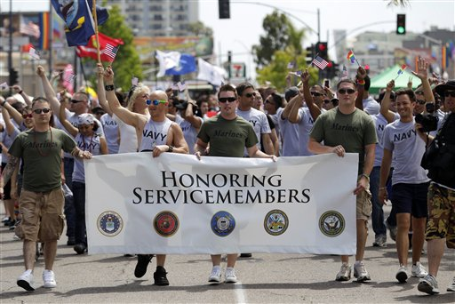 Service members march in last year's Gay Pride Parade in San Diego. The Defense Department has announced it is allowing service members to march in uniform in this year's parade for the first time in U.S. history.