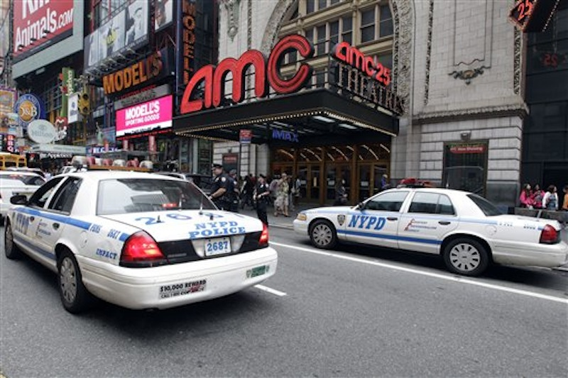 "Police officers are seen outside a movie theater screening ""The Dark Knight Rises,"" Friday, July 20, 2012 in New York. A gunman in a gas mask barged into a crowded Denver-area theater during a midnight premiere of the Batman movie on Friday, hurled a gas canister and then opened fire, killing 12 people and injuring at least 50 others in one of the deadliest mass shootings in recent U.S. history. NYPD commissioner Ray Kelly said the department was providing the extra security at theaters ""as a precaution against copycats and to raise the comfort levels among movie patrons."" (AP Photo/Mary Altaffer)"