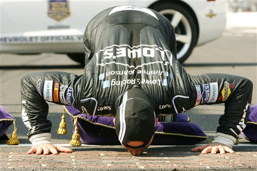 Jimmie Johnson kisses the yard of bricks as he celebrates his win at the NASCAR Sprint Cup Series auto race at Indianapolis Motor Speedway on Sunday in Indianapolis. 2012;Crown Royal presents the Curtiss Shaver 400 at the Brickyard;NASCAR;Practice;Indianapolis Motor Speedway;July;Sprint Cup Series;Indianapolis;Indiana;Autostock