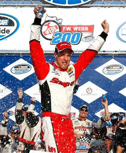 Brad Keselowski stands on his car as he celebrates in victory lane after winning the NASCAR Nationwide Series auto race at New Hampshire Motor Speedway, Saturday, July 14, 2012, in Loudon, N.H. (AP Photo/Autostock, Russell LaBounty) MANDATORY CREDIT 2012;F.W. Webb 200;NASCAR;Race;New Hampshire Motor Speedway;July;Nationwide Series;Loudon;New Hampshire;Autostock