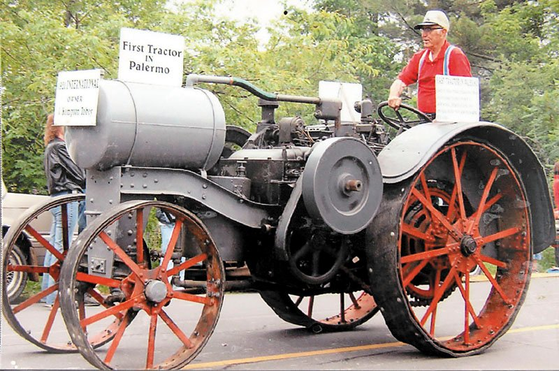 Kempton Tobey sits on this grandfather's tractor, the first tractor in Palermo.