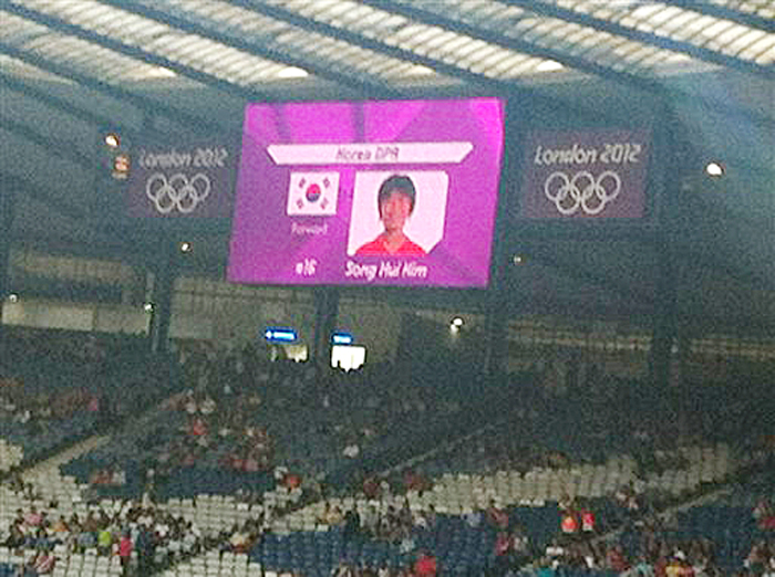This photo cellphone shows a mistakenly displayed South Korean flag on a jumbo screen instead of North Korea's, before a women's soccer match that prompted the North Koreans to refuse to take the field for nearly an hour on Wednesday.