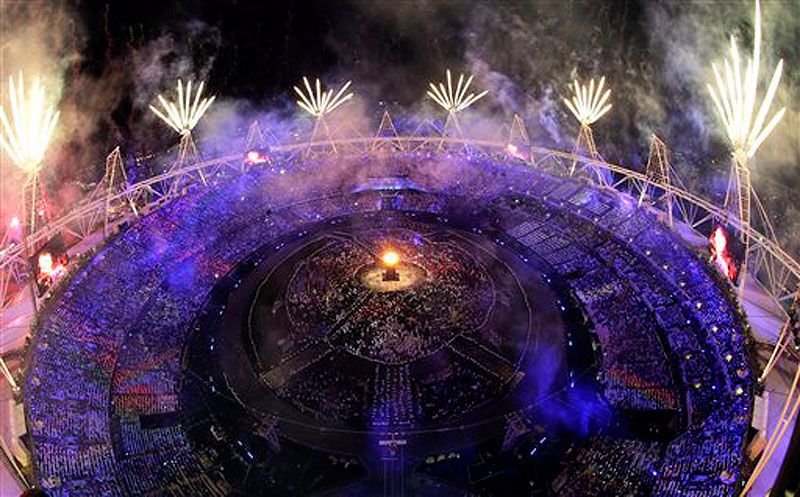 Fireworks light up over the stadium during the Opening Ceremony at the 2012 Summer Olympics, Saturday, July 28, 2012, in London. (AP Photo/David J. Phillip) 2012 London Olympic Games Summer Olympic games Olympic games Spo