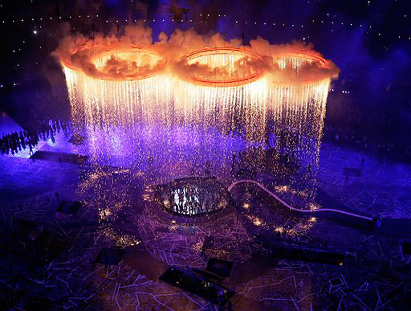 The Olympic rings light up the stadium during the Opening Ceremony at the 2012 Summer Olympics, Friday, July 27, 2012, in London. (AP Photo/Morry Gash, Pool) 2012 London Olympic Games Summer Olympic games Olympic games Spo