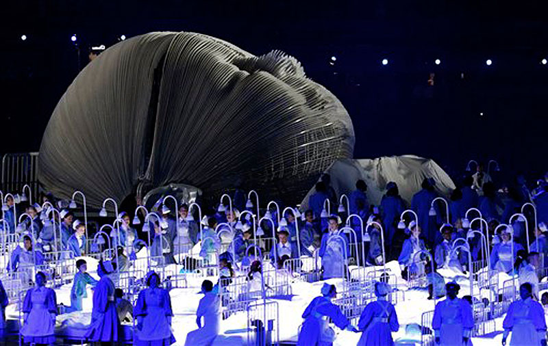 Actors perform in a sequence meant to represent Britain's National Health Service (NHS) perform during the Opening Ceremony at the 2012 Summer Olympics, Friday, July 27, 2012, in London. (AP Photo/Jae C. Hong) 2012 London Olympic Games Summer Olympic games Olympic games Spo