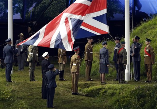 The British flag is raised up during the Opening Ceremony at the 2012 Summer Olympics, Friday, July 27, 2012, in London. (AP Photo/Paul Sancya) 2012 London Olympic Games Summer Olympic games Olympic games Sports Events XXX Olympiad