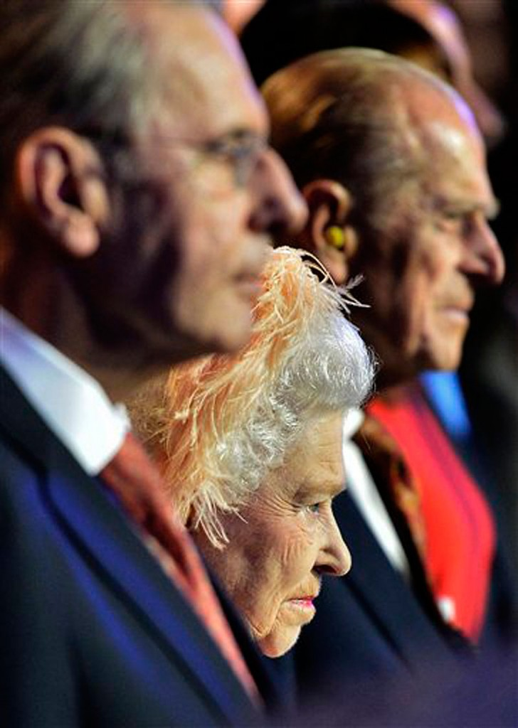 Britain's Queen Elizabeth II, center, Britain's Prince Philip, the Duke of Edinburgh, right, and IOC President Jacques Rogge, left, attend the Opening Ceremony of the 2012 Olympic Summer Games at the Olympic Stadium in London, Friday, July 27, 2012. (AP Photo/Toby Melville, Pool) 2012 London Olympic Games Summer Olympic games Olympic games Spo