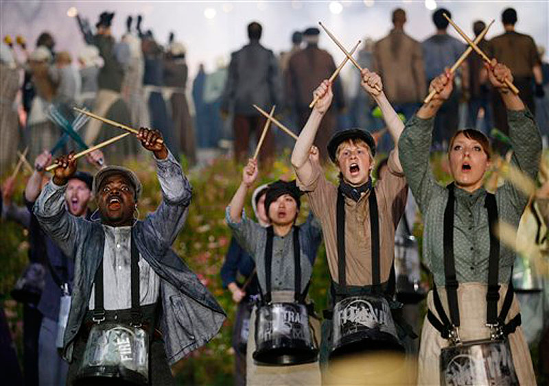 Performers play drums during the Opening Ceremony at the 2012 Summer Olympics, Friday, July 27, 2012, in London. (AP Photo/Matt Dunham) 2012 London Olympic Games Summer Olympic games Olympic games Spo