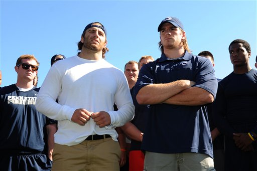 Penn State senior running back Michael Zordich, left, and senior linebacker Michael Mauti give a statement in support of their team, as other players look on Wednesday in State College, Pa.