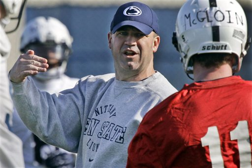 Penn State football coach Bill O' Brien gives instruction to quarterback Matt McGloin in this March 26, 2012, photo.