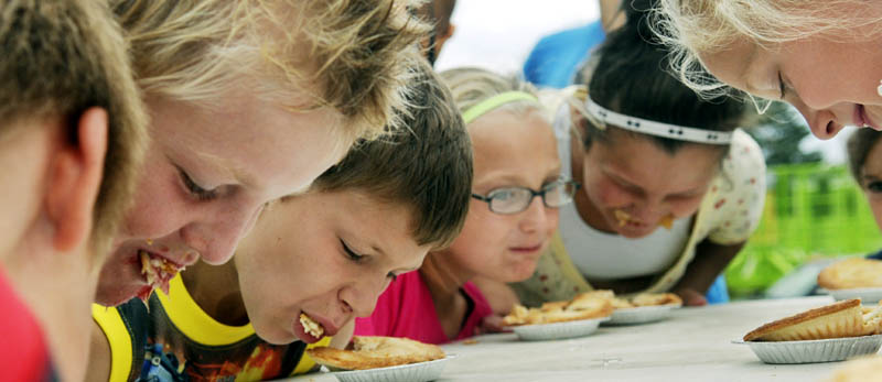 Children consume pie Sunday during a contest to determine who could eat one the fastest during the final day of the Pittston Fair.