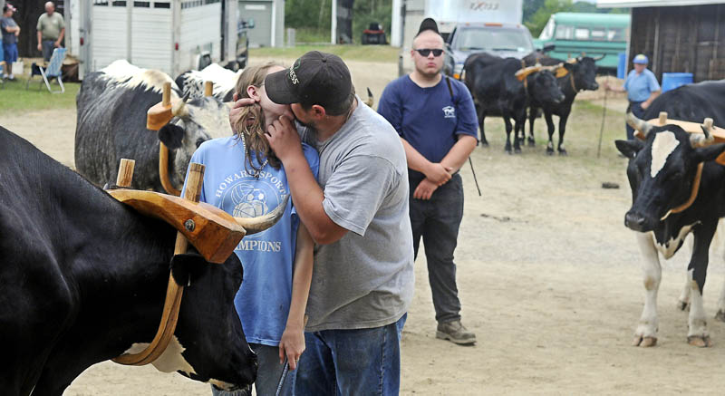 Joseph Couture, of Jay, kisses his girlfriend, Tammy Chase, of Wilton, before she shows her steers Sunday at the Pittston Fair. Several classes of steer and oxen were exhibited on the final day of the agricultural exhibition.