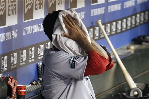 Boston Red Sox starting pitcher Felix Doubront puts a towel on his face in the dugout after he was pulled during the sixth inning of a baseball game against the Texas Rangers, Monday, July 23, 2012, in Arlington, Texas. The Rangers won 9-1. (AP Photo/LM Otero)