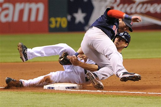 Boston Red Sox third baseman Nick Punto, left, gets the out on Tampa Bay Rays base runner Ben Zobrist to complete the double play during the eighth inning of a baseball game, Friday, July 13, 2012, in St. Petersburg, Fla. (AP Photo/Brian Blanco)