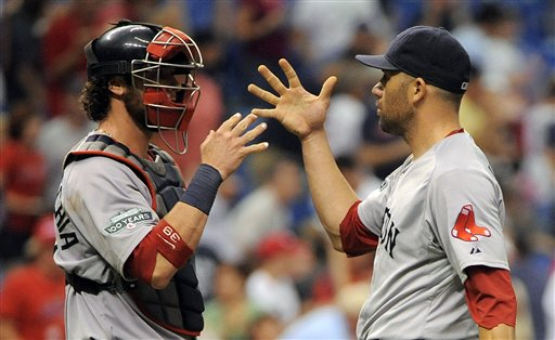 Boston Red Sox catcher Jarrod Saltalamacchia, left, and pitcher Alfredo Aceves celebrate their 7-3 win over the Tampa Bay Rays at the end of a baseball game, Sunday, July 15, 2012, in St. Petersburg, Fla. (AP Photo/Brian Blanco)