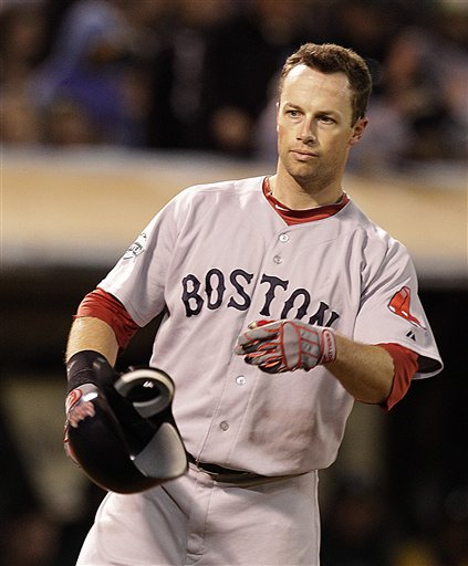 Boston Red Sox's Daniel Nava tosses his helmet after striking out to Oakland Athletics' Sean Doolittle in the seventh inning of a baseball game Monday, July 2, 2012, in San Francisco. (AP Photo/Ben Margot)