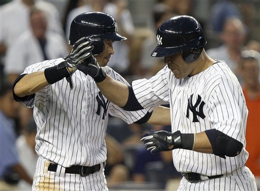 New York Yankees' Russell Martin, right, is greeted by teammate Ichiro Suzuki after hitting a two-run home run during the fourth inning of a baseball game Friday against the Boston Red Sox at Yankee Stadium in New York.