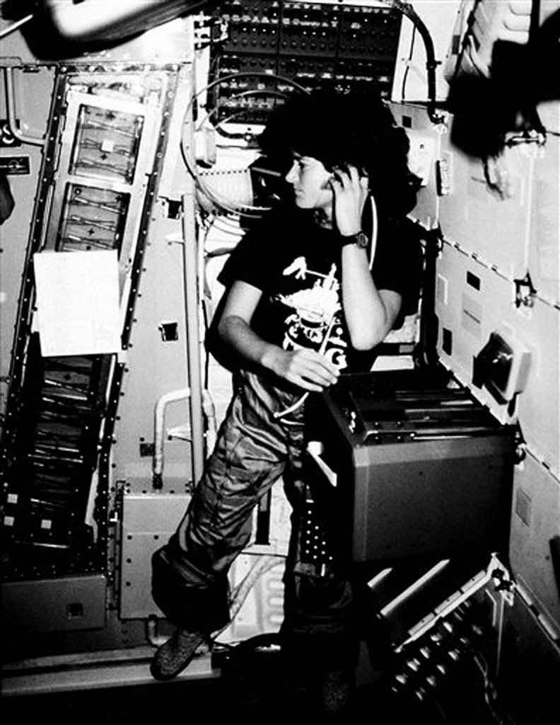 In this June 1983 file photo provided by NASA, astronaut Sally K. Ride, STS-7 mission specialist, communicates with ground controllers from the mid-deck of the earth-orbiting Space Shuttle Challenger. Ride, the first American woman in space, died Monday, July 23, 2012 after a 17-month battle with pancreatic cancer. She was 61. (AP Photo/NASA, File)