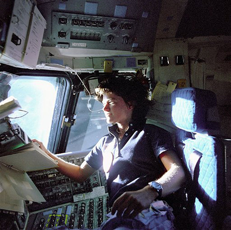 In this June 1983 photo released by NASA, astronaut Sally Ride, a specialist on shuttle mission STS-7, monitors control panels from the pilot's chair on the shuttle Columbia flight deck. Ride, the first American woman in space, died Monday, July 23, 2012 after a 17-month battle with pancreatic cancer. She was 61. (AP Photo/NASA, File)